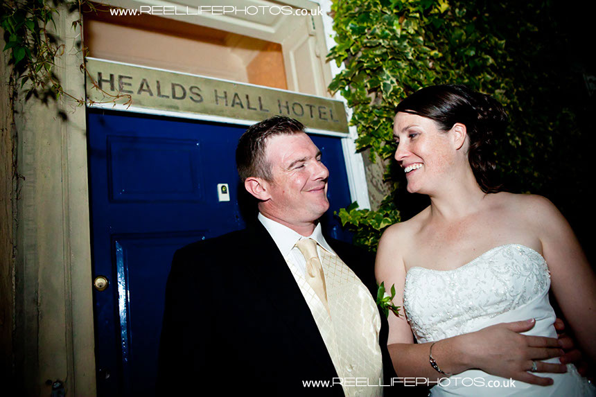 Bride and groom at night at Healds Hall wedding