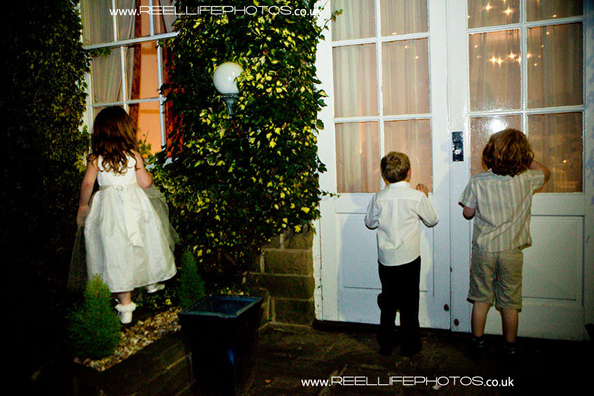 natural wedding pictures of children outside Helads Hall at night