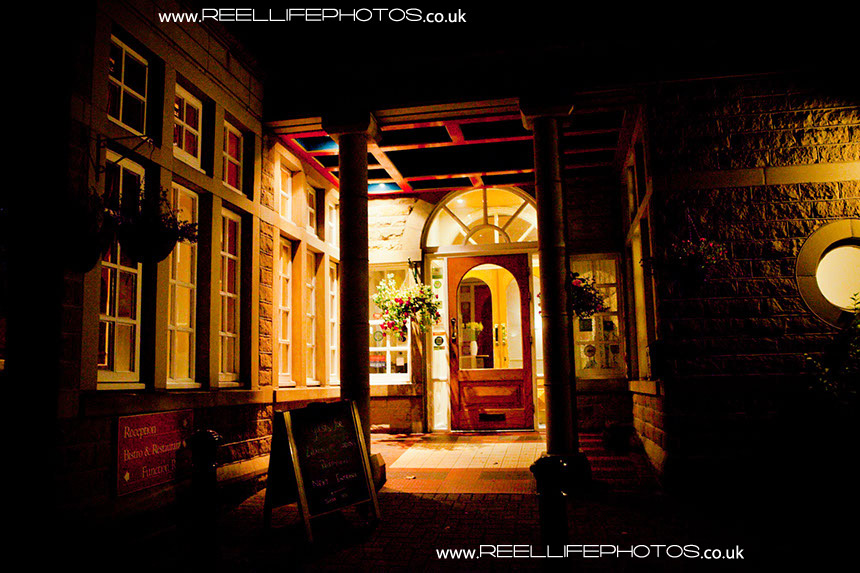 Healds Hall Hotel main entrance at night
