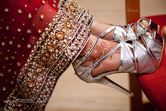 Asian wedding photography international - bride's shoes and lengha in Norway