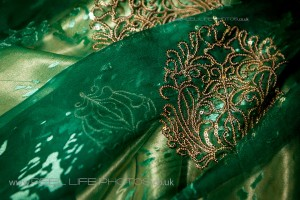 Gold thread embroidery on Somali dirac dress for bride's wedding