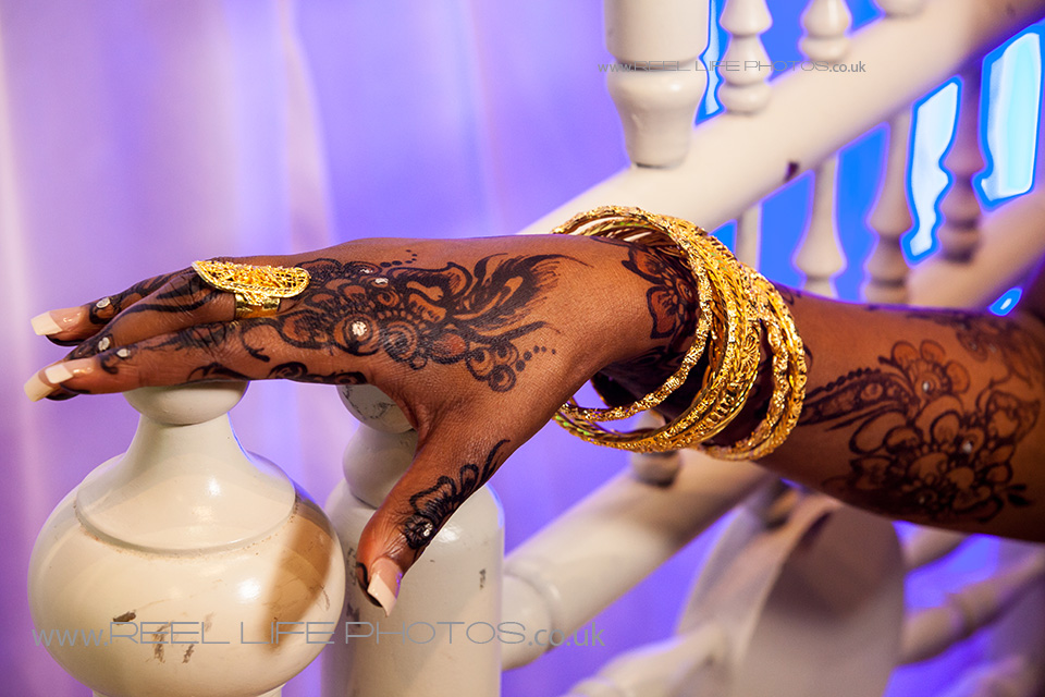Somali bride's hand with gold bracelets