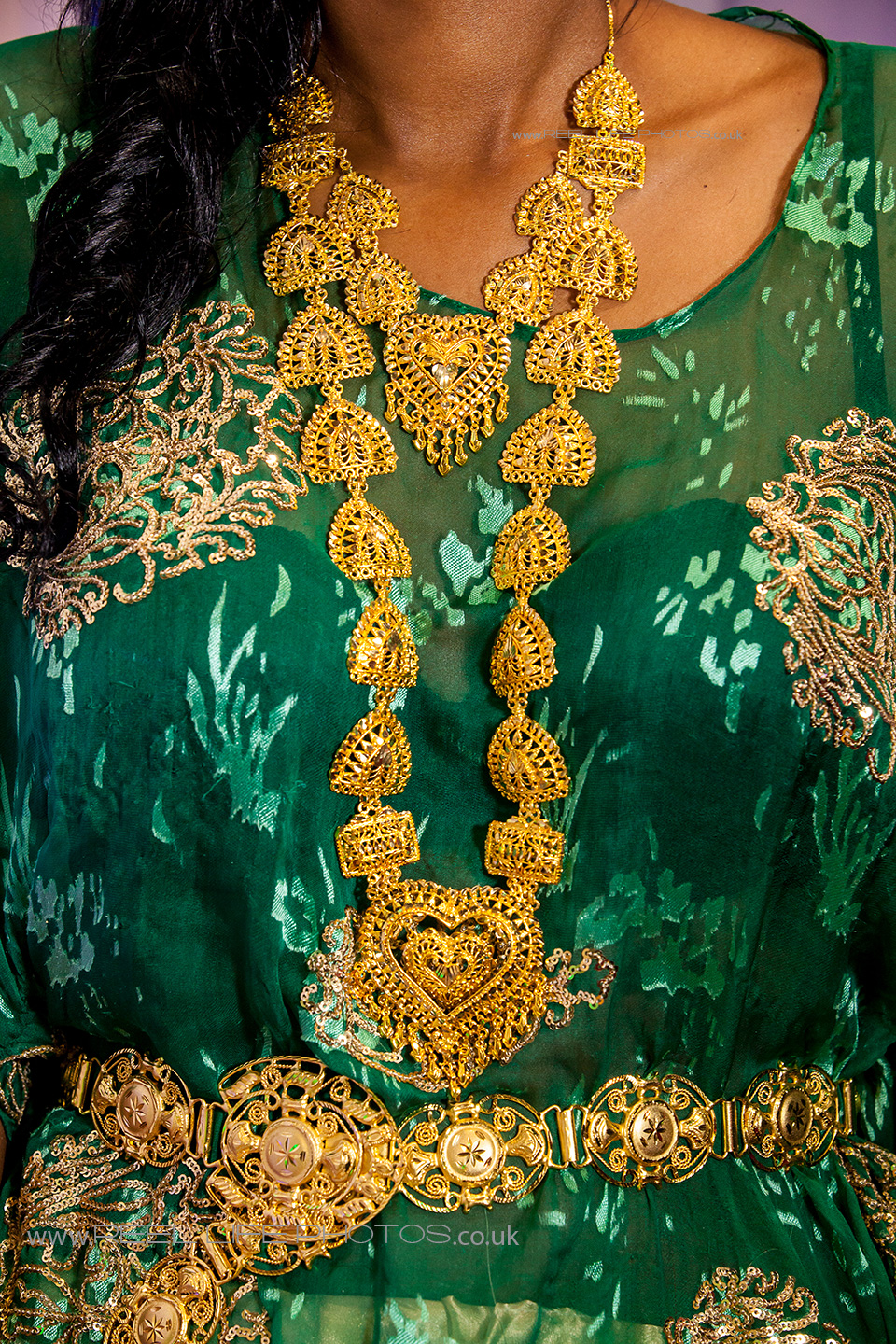 Somali gold wedding jewellery worn over green dirac wedding dress