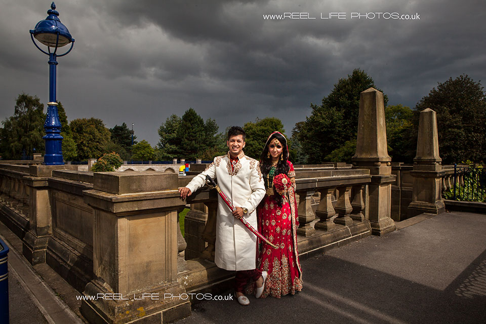 Traditional posed Asian wedding picture in Bradford with dramatic light