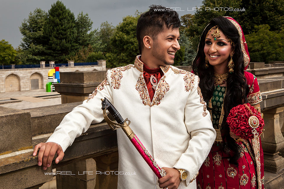 Happy natural Asian wedding picture in the park in Bradford