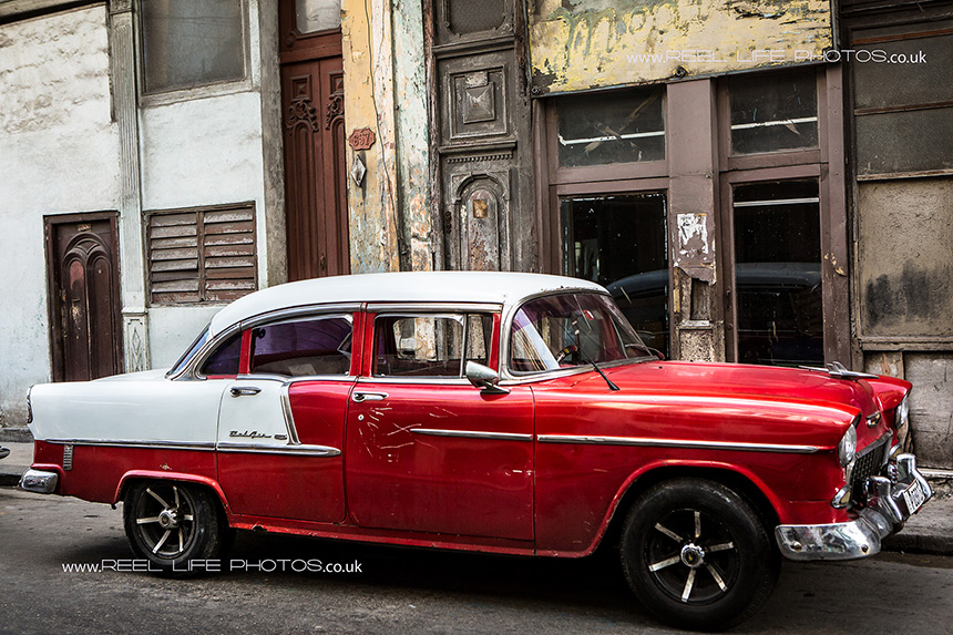Red and white classic Cuban car in Old Havana