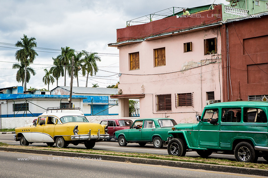 Real life in Cuba - colourful classic cars on the road in Havana