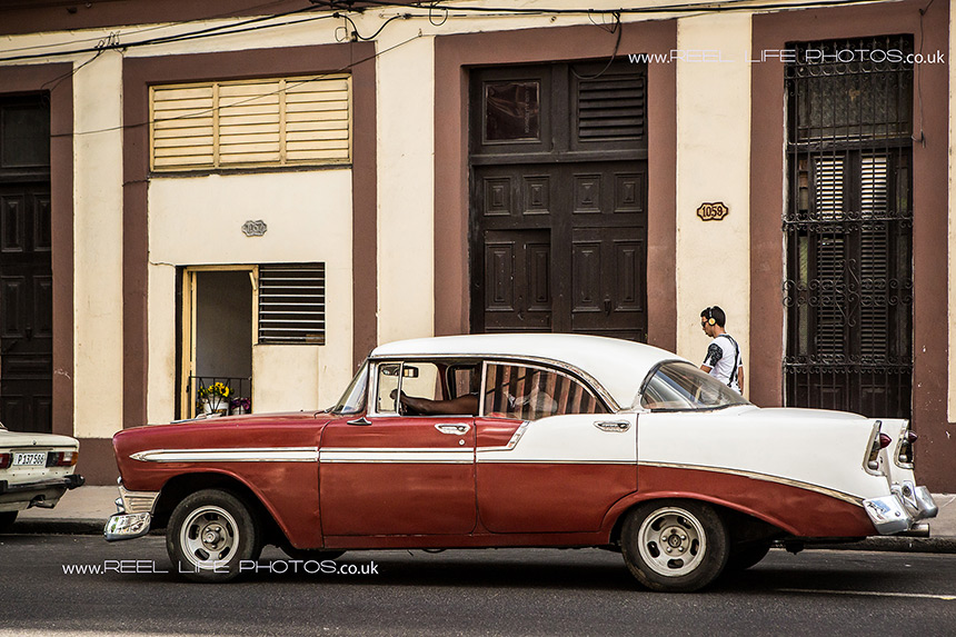 Cuban classic car driving along the streets of Old Havana