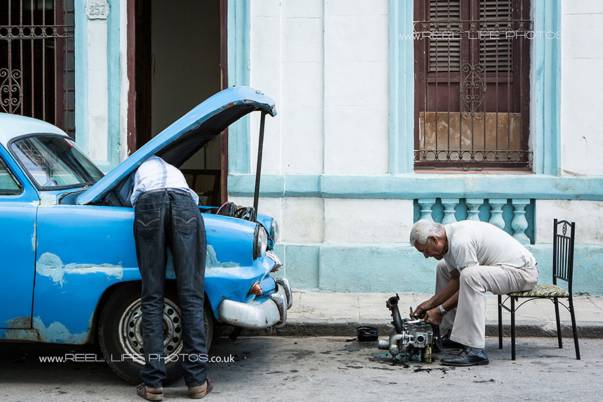 Real life in Cuba as an engine is taken apart in the street