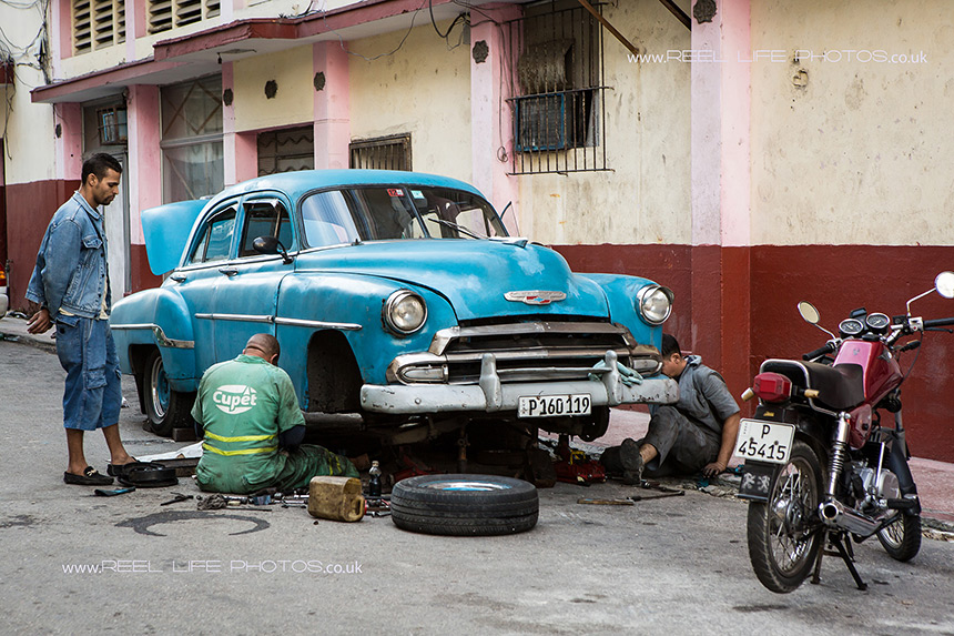 Roadside mechanics - real life in Cuba.  Copyright Reel Life Photos
