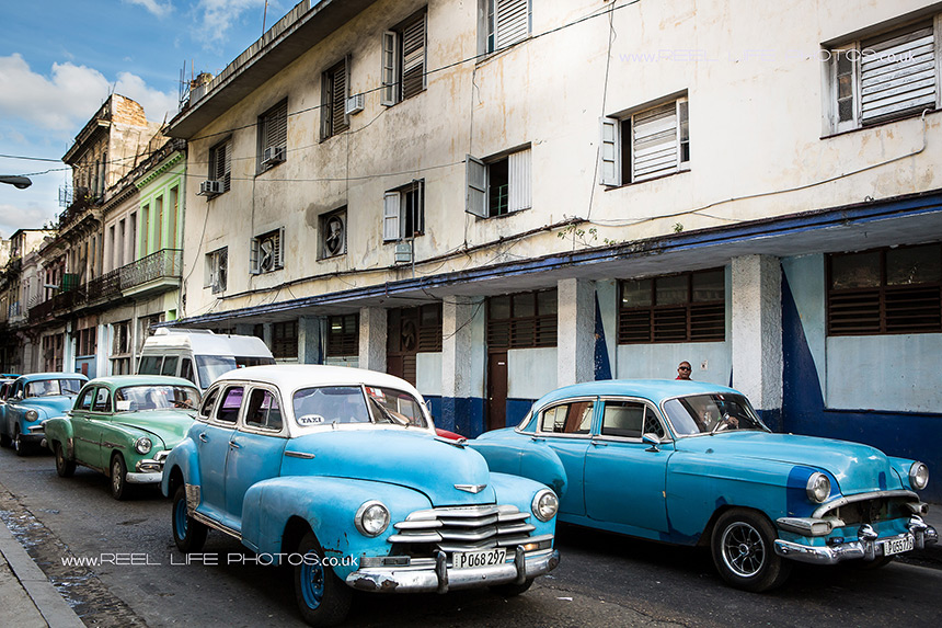 Real life in Cuba - classic Cuban  cars still driving round Havana.