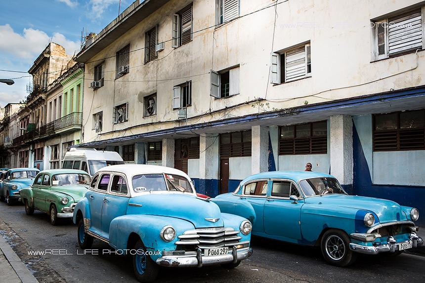 Real life in Cuba - classic Cuban  cars still driving round Havana.