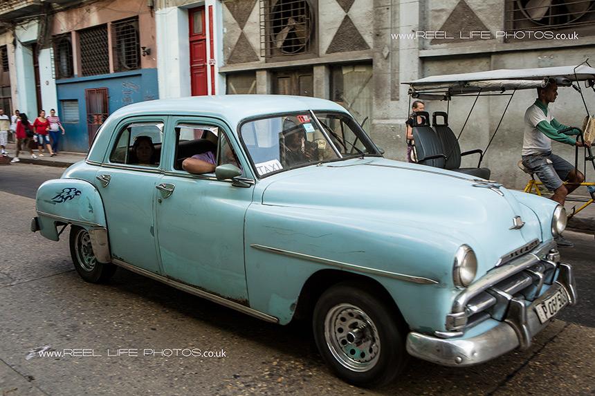 Old Cuban taxi in Havana.  Copyright Reel Life Photos