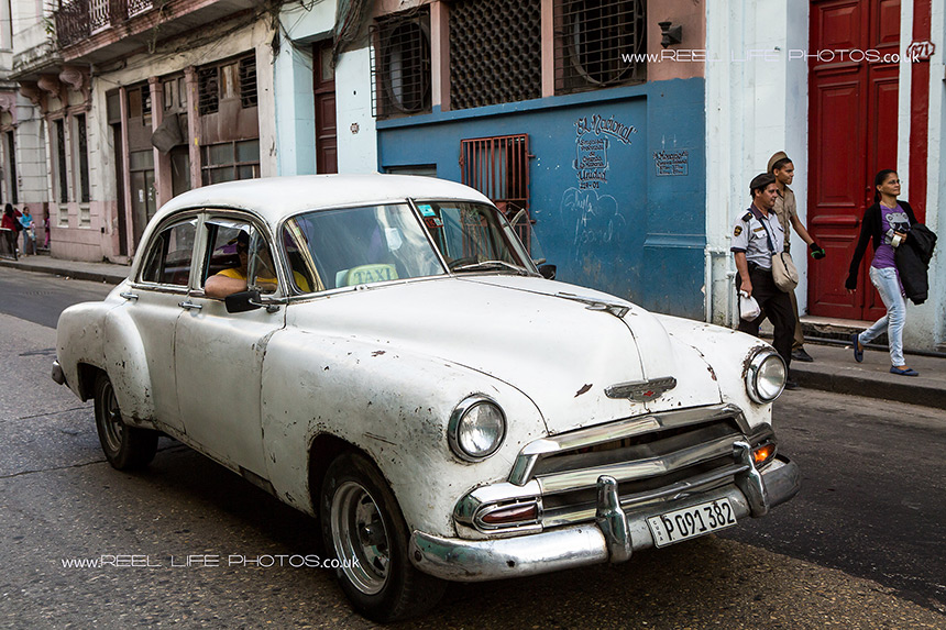 Old white taxi  - classic American car in Cuba