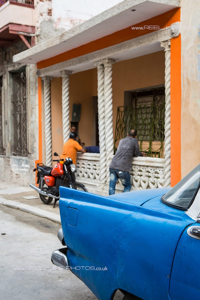 Life in Cuba, car, moped, and Cubans