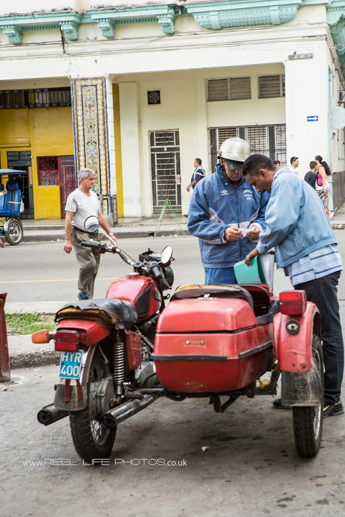 Red motorbike with sidecar in Cuba