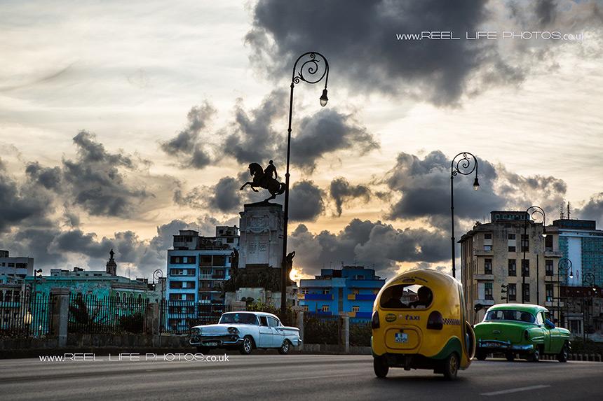 Plaza de Maceo, Havana, Cuba with old Cuban cars at night.