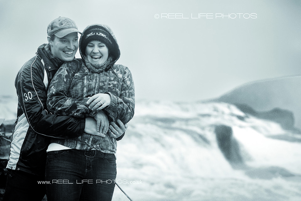 Reprtage rather than posed engagement photos in Iceland on a rainy October day at Selfoss waterfall.