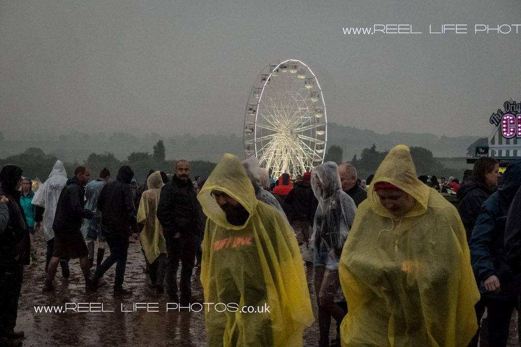 Download 2016 at night with the Ferris Wheel and plastic ponchos