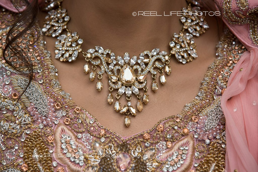 bride's necklace at wedding at The Grand Banqueting Suite in West Yorkshire