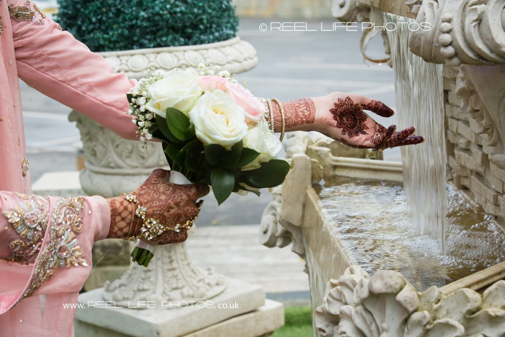Pictures of Asian bride by the fountain at The Grand in West Yorkshire