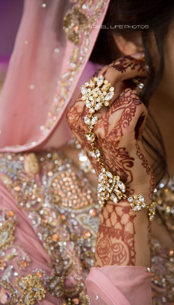 Asian wedding jewellery on teh bride;s hand at The Grand in West Yorkshire
