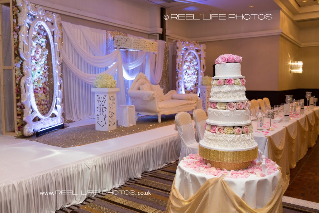 wedding cake and stage at Arabic Asian wedding