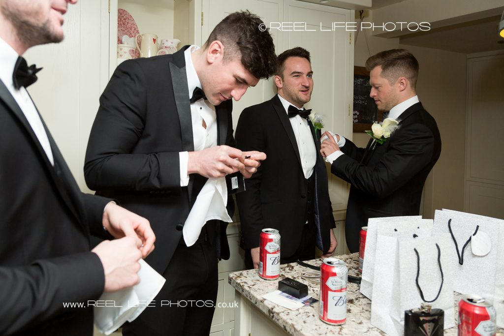Groomsmen preparing for Great Gatsby wedding