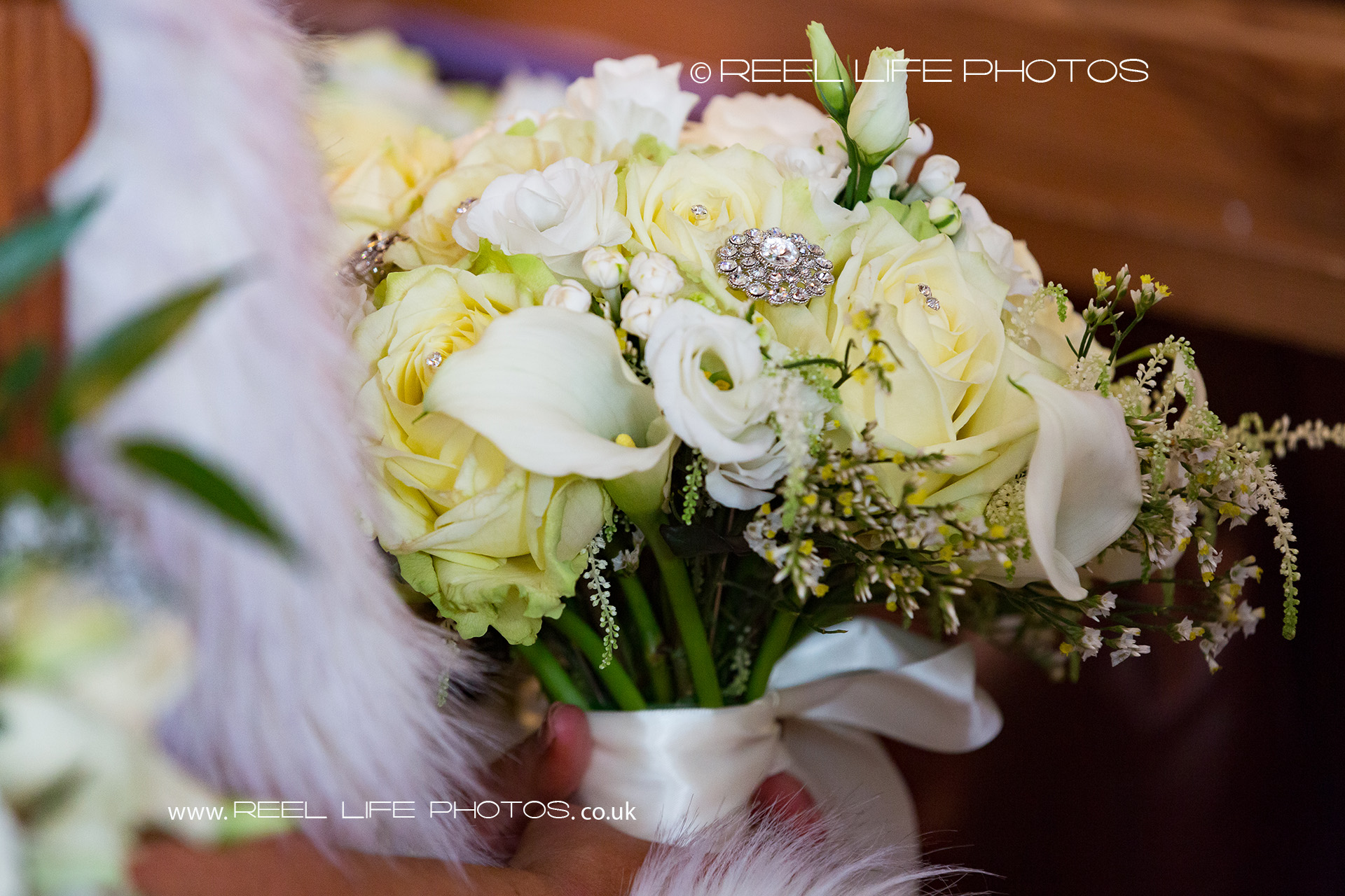 Wedding bouquet with lemon and white roises and white lillies