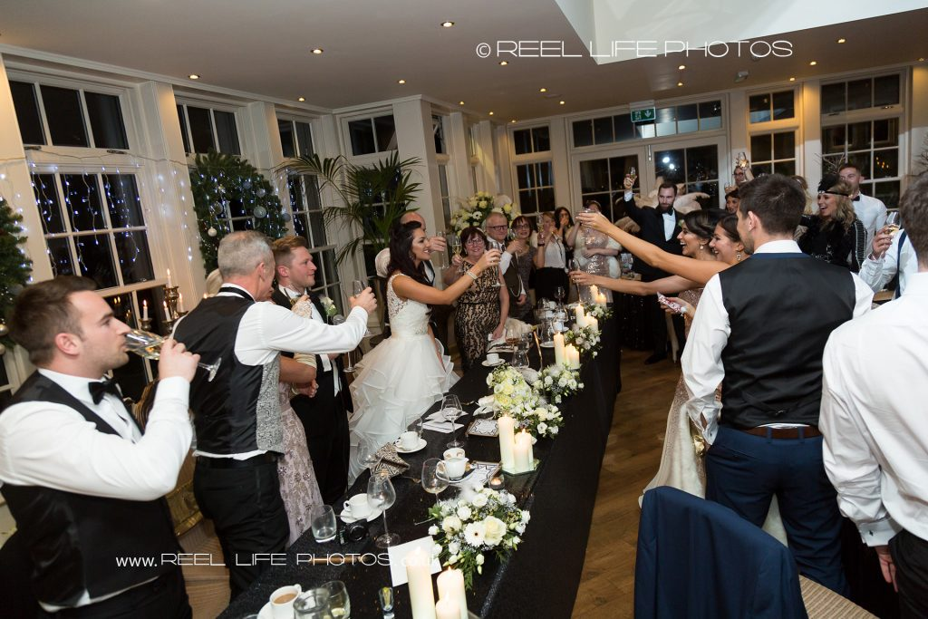 Toasts during wedding speeches at Mitton Hall