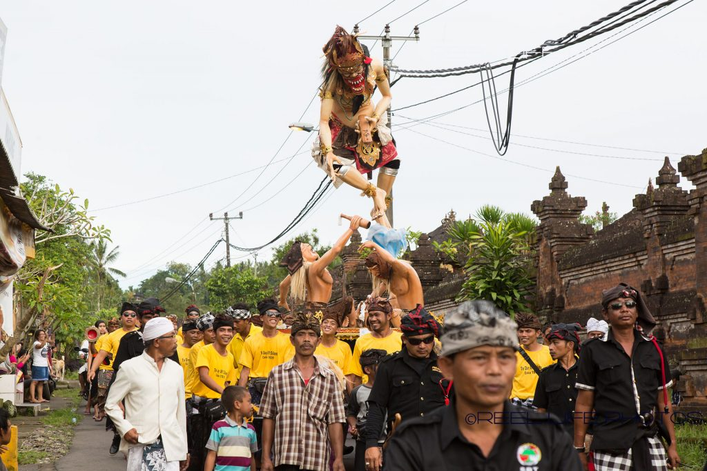 Balinese hildren carry the Ogoh-Ogoh they have made to drive out the evil spirits before Nyepi - quiet day throughout all of Bali