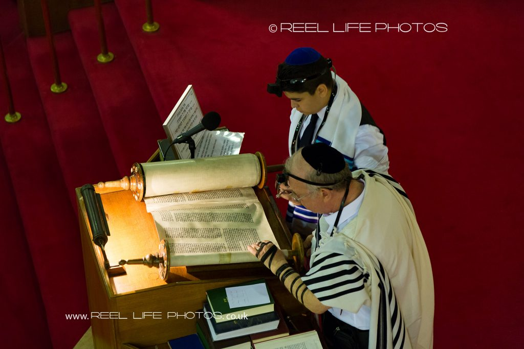 The pre-Bar Mitzvah boy reading passages from The Torah during Tefillin at Jackson Row Synagogue