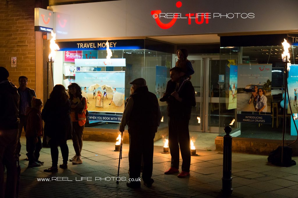 Crowds by Tui in Dewsbury at night during Togethering arts event