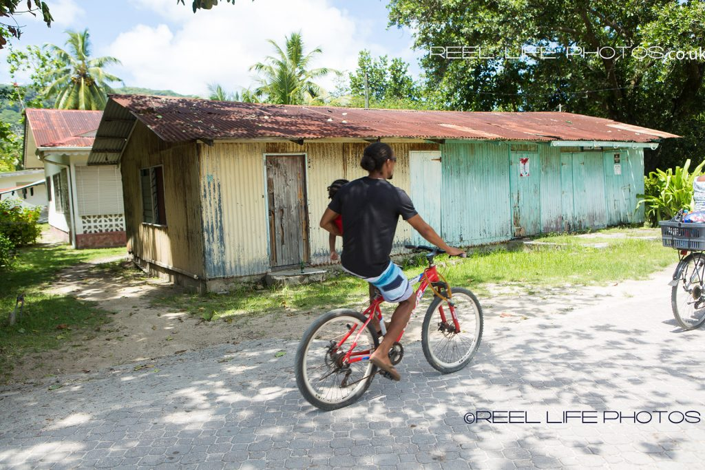 Cyclist on La Digue, island in the Seychelles