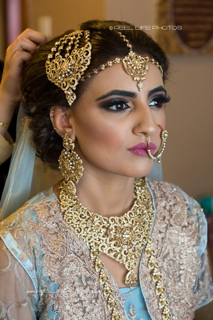 Asian wedding photographer in Batley photographs the bride with Asian wedding jewellery