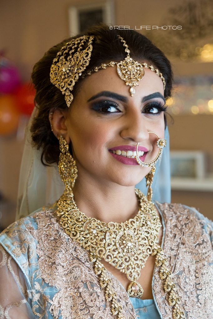 Natural smiles from beautiful Asian  bride  before her Islamic wedding in Batley