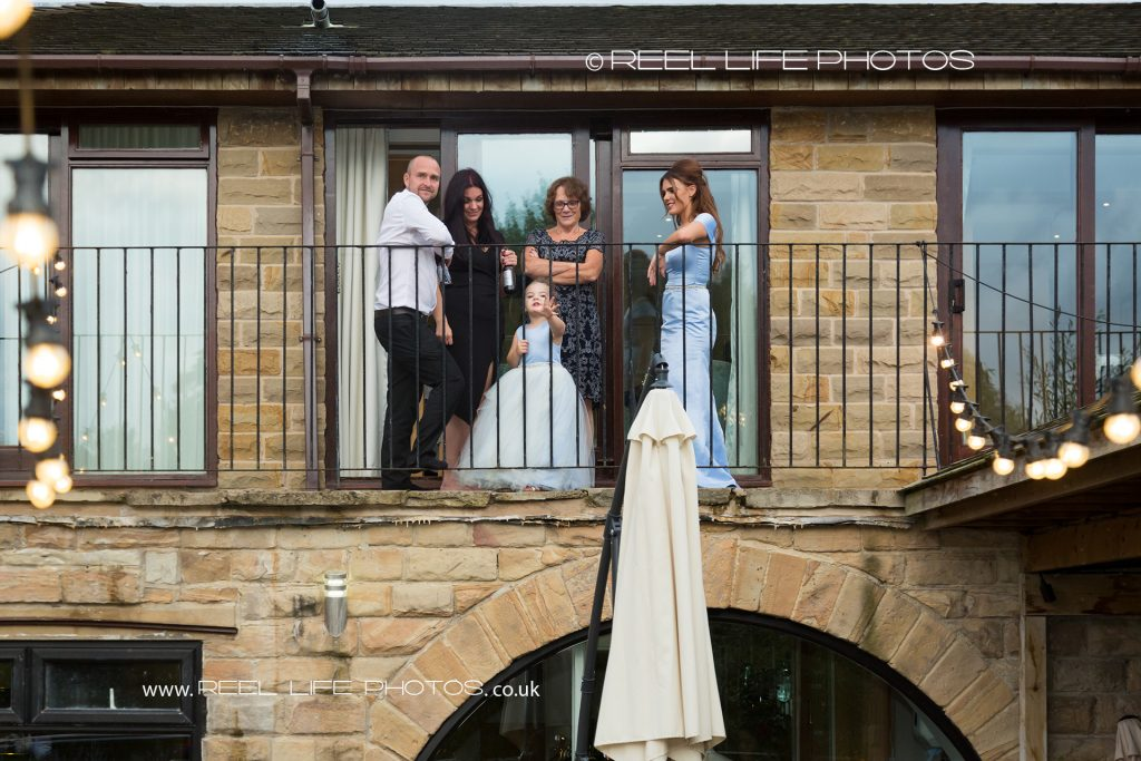 Wedding guests on the balcony at the back of Walton Hall, Waterton Park Hotel, at the start of the evening wedding reception