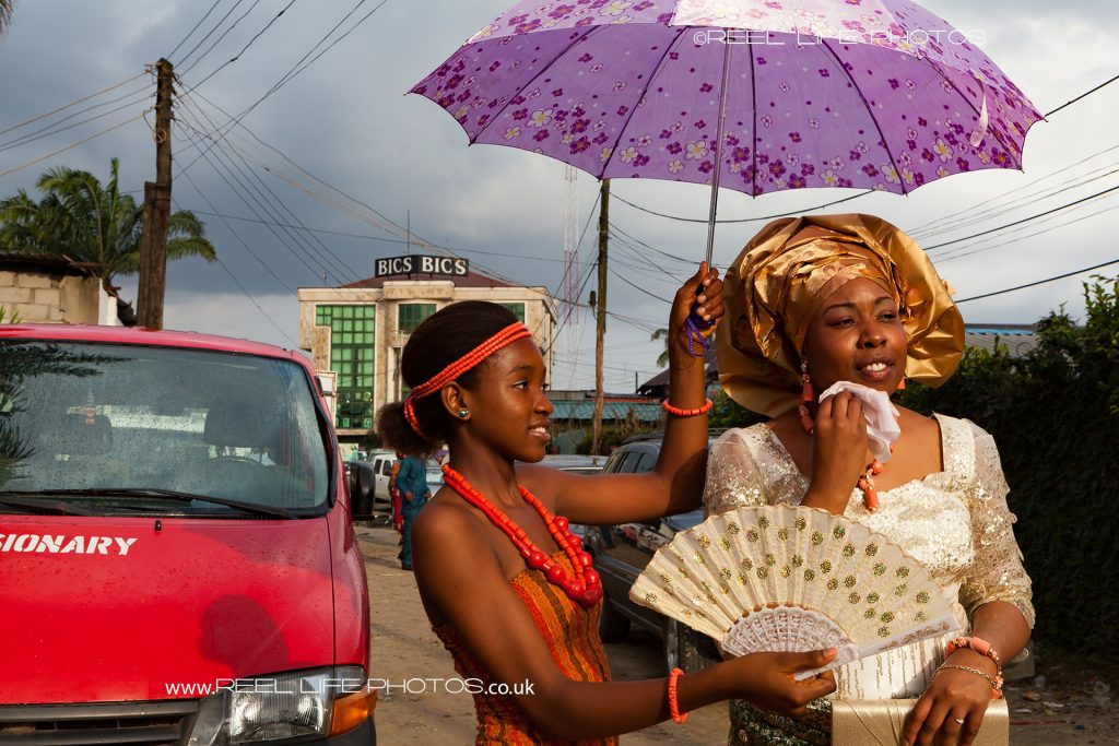 Bride shielded from the sun in Nigeria