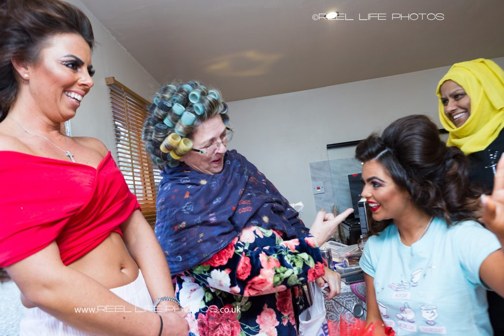 fun wedding picture of bride's traveller family getting ready for the wedding
