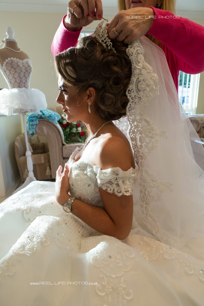 Traveller bride having her wedding veil pinned on