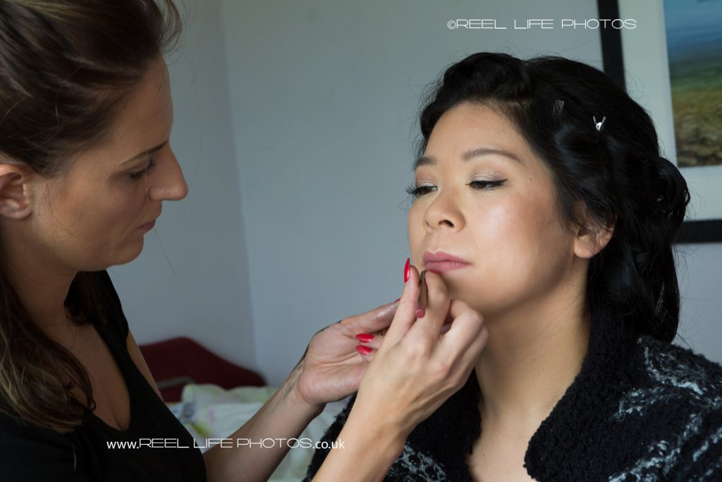 Make Up Artist at work on the Chinese bride
