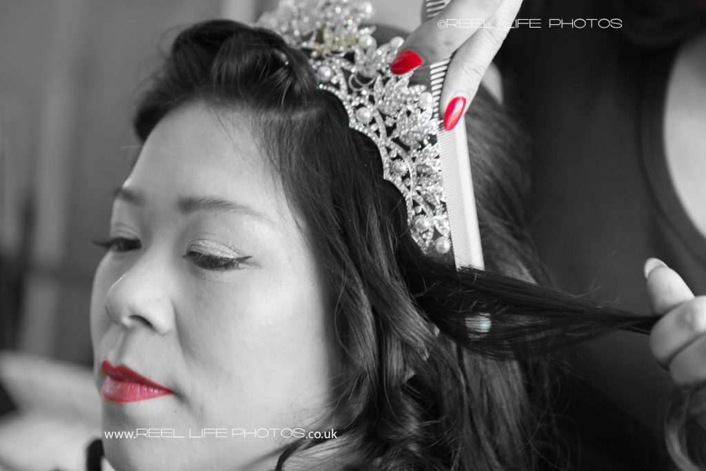 Chinese bride's face in black and white with red spot colour