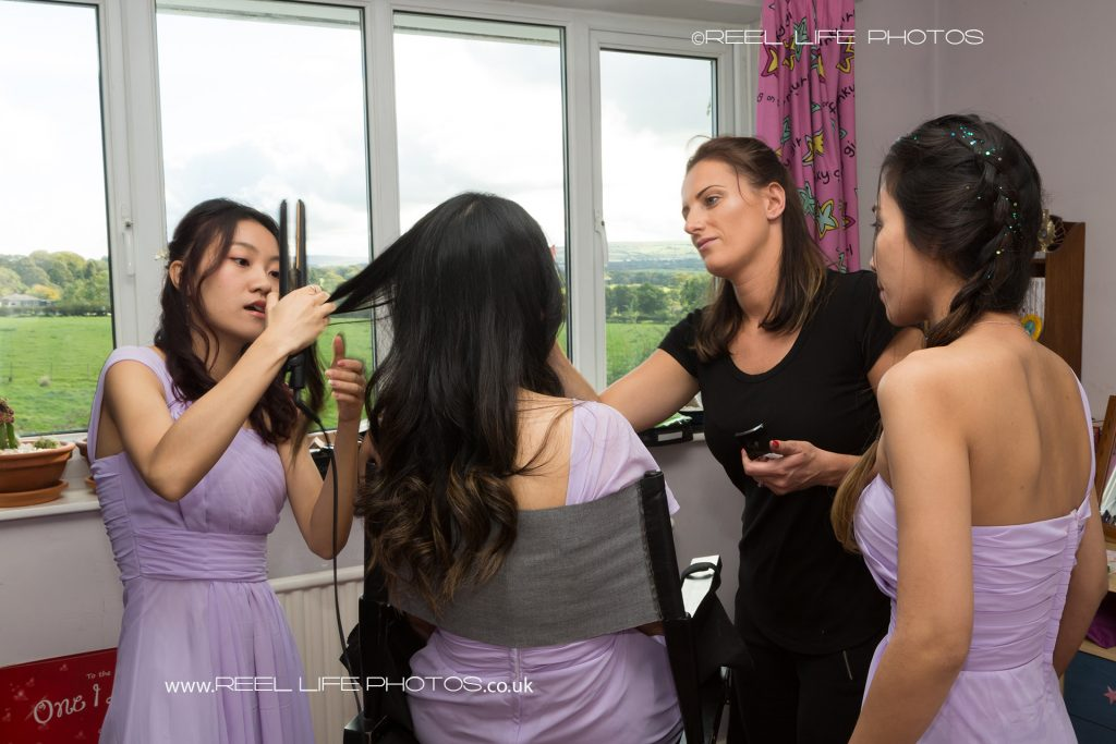 Bridesmaids having hair and makeup done