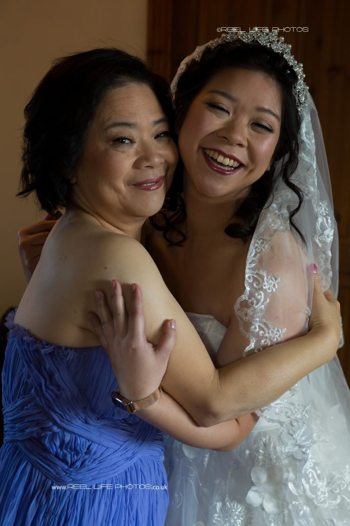 Chinese bride hugging her mum