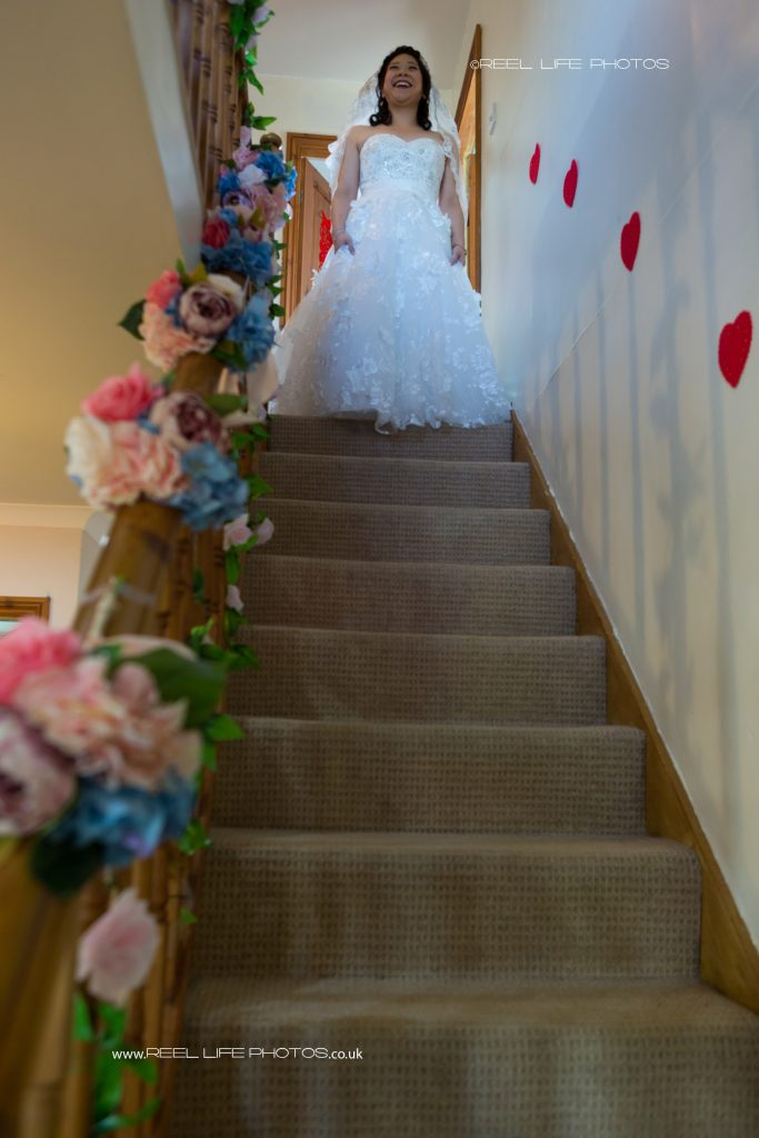 Chinese bride descending the staircase