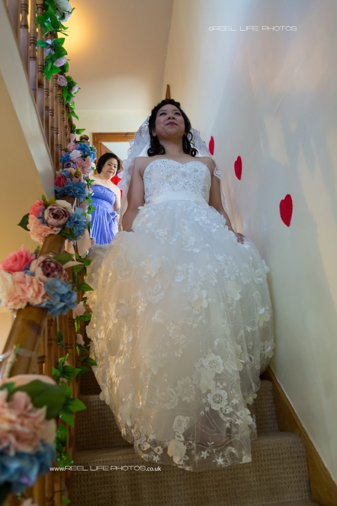 Chinese bride coming down the stairs