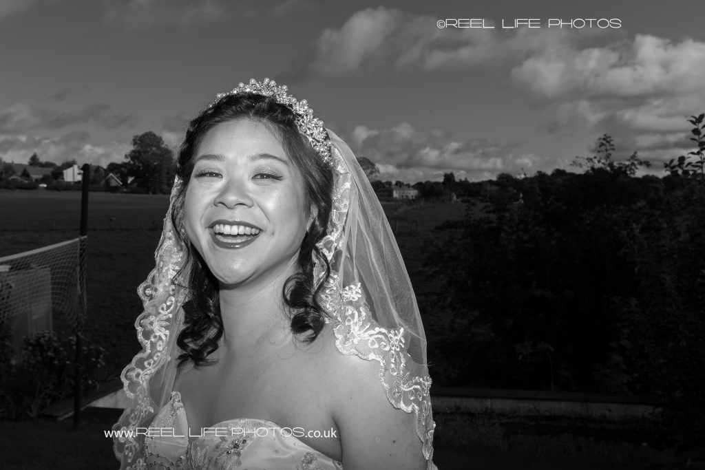 Happy Chinese bride in black and white