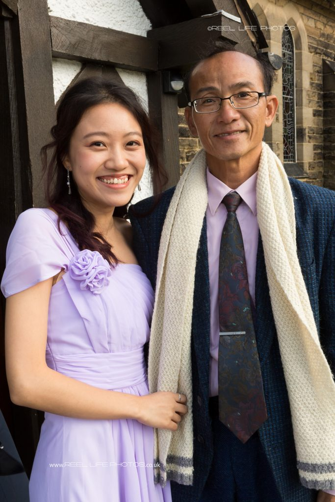 Chinese bridesmaid and her father